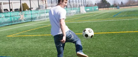 LUCI LOBE The Vermont Cynic Junior Midfielder Theodore Gula practices his footwork during the offseason at Virtue Field March 26. For Many players, the offseason is the time to develop as a player, while the in season is the time they utilize their new skills.