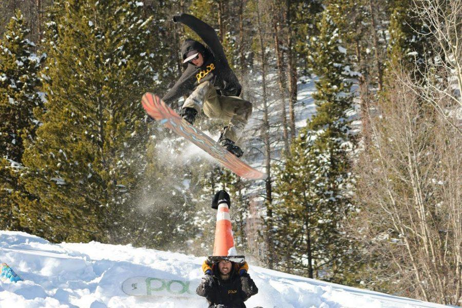 """A snowboarder wearing Powe products hits a jump last winter with Powe's snowboard the """"Vt. Chedda Shredda,"""" Powe currently offers five snowboards on their website, with three only available for pre-order in anticipation of this year's season. PHOTO COURTESY OF POWE SNOWBOARDS"""