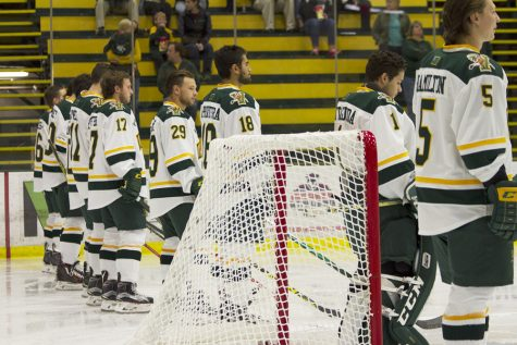 The men's hockey team lines up before their Oct. 4. exhibition game against Acadia University. DAYNA WYCKOFF/The Vermont Cynic