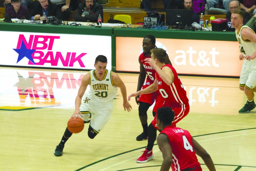 UVM sophomore guard Ernie Duncan drives to the hoop against Marist.