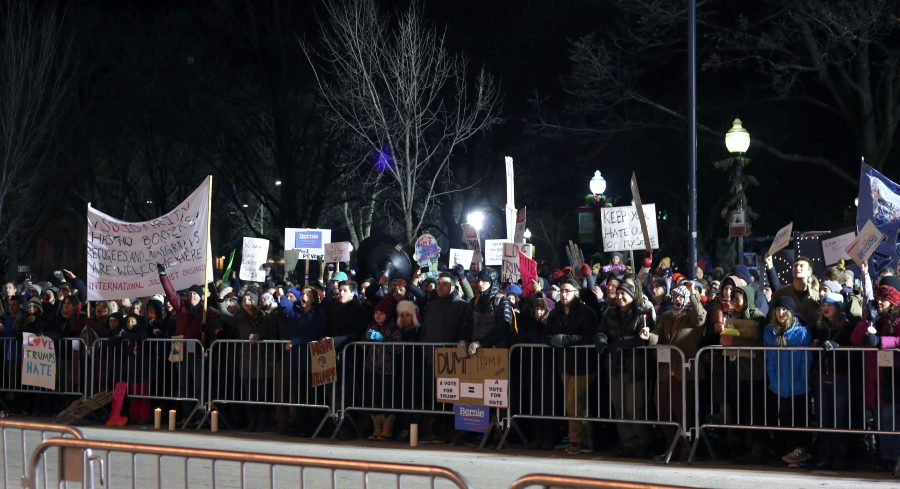 Residents stand across the street from the Flynn to protest Donald Trump's rally Jan. 7. RYAN THORNTON/The Vermont Cynic
