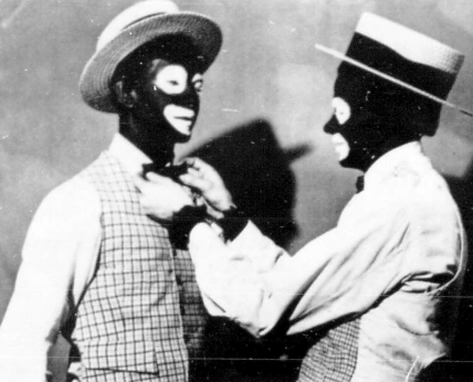 Two fraternity members in blackface for the 1959 Kake Walk.