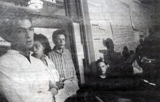 Students of color stand in the Waterman building which they have been occupying for three days in April 21, 1988.