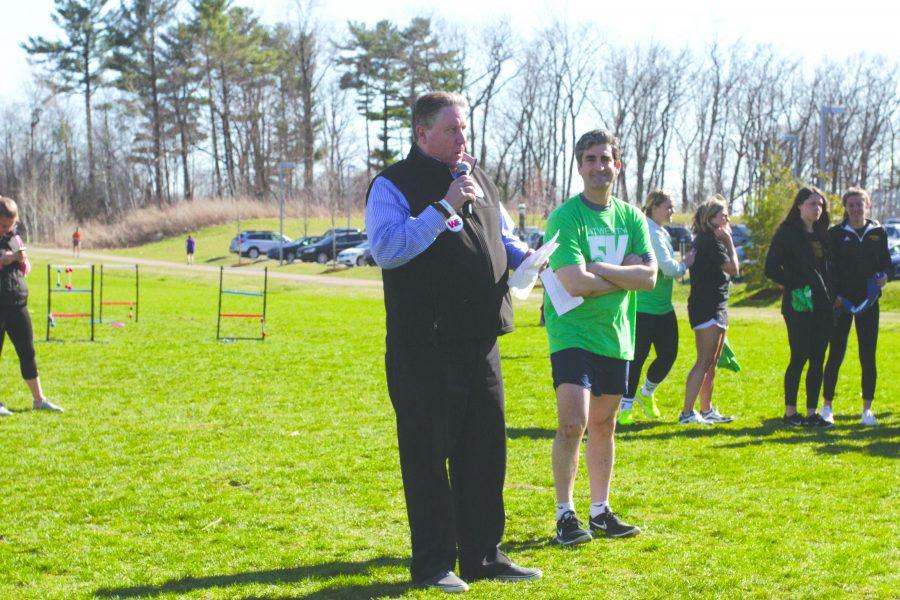 (Left to right) James Hudziak, Wellness Environment director and Mayor Miro Weinberger count down to the start of Wellness Environment 5k April 20.