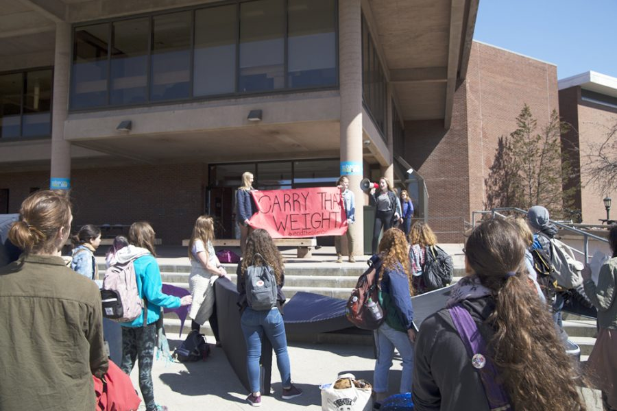 The Carry That Weight movement protests sexual assault on college campuses outside Bailey/Howe Library April 15. The protest was sponsored by SGA as a part of Sexual Violence Awareness Month.  PHIL CARRUTHERS/The Vermont Cynic