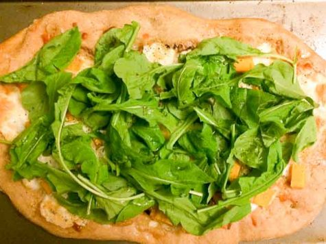 A pizza made from fresh, local ingredients