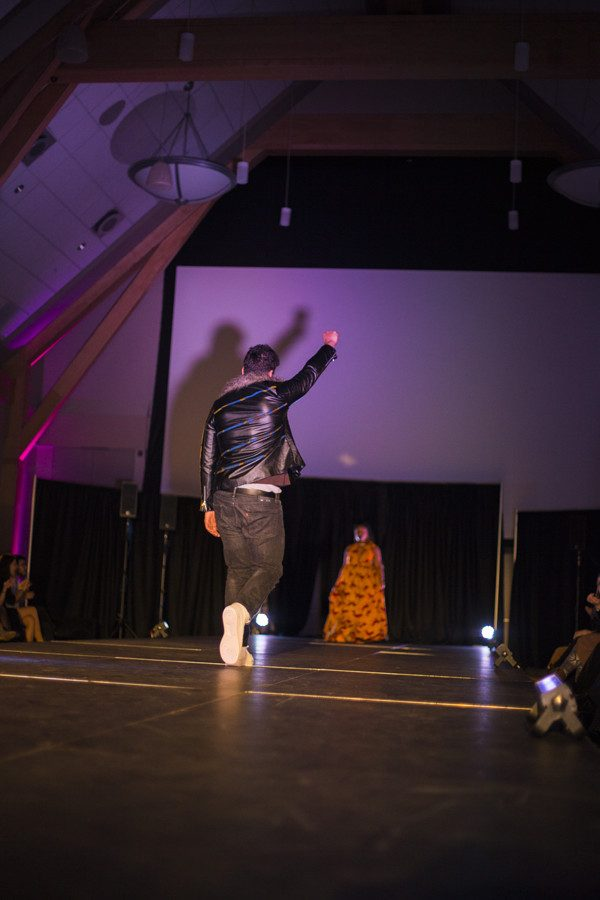 Members of the UVM Black Student Union walk at the annual Black Fashion Show Feb. 25.  Phil Carruthers | The Vermont Cynic