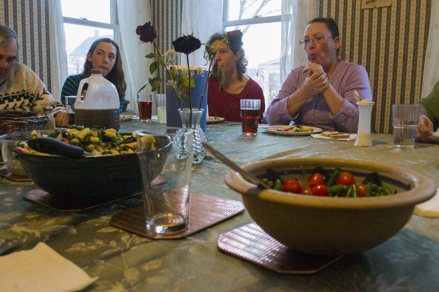 MAX MCCURDY/The Vermont Cynic Members of the Dismas house gather for their nightly community dinner on March 24. The Dismas House is a national nonprofit that houses former prisoners alongside college students.