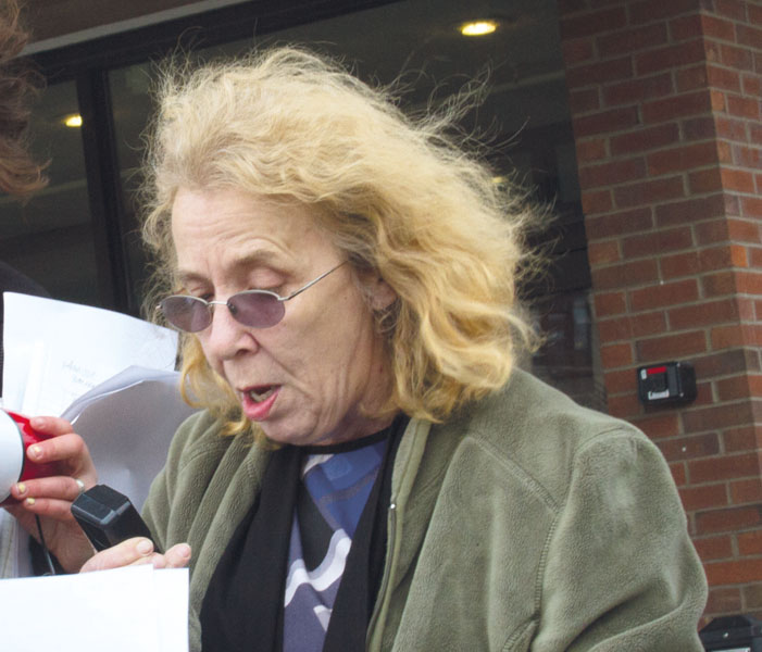 Deb Ploof, Sodexo employee at the Cyber Cafe, speaks during the 'Justice for Cindy Smith' rally outside of Bailey/Howe library April 24.