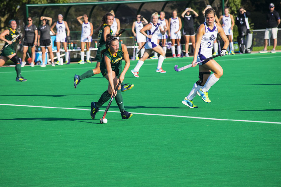 First-year midfielder Claudia Cotter moves the ball up the field against Holy Cross Sept. 19