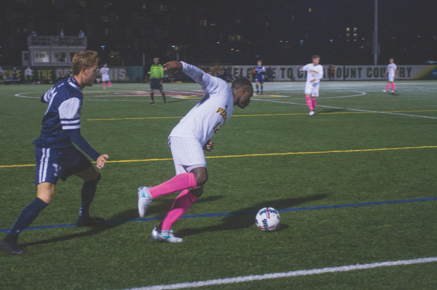 Junior midfielder Mikel Kabala steals the ball from a Yale player Sept. 9. The Catamounts won 1-0.