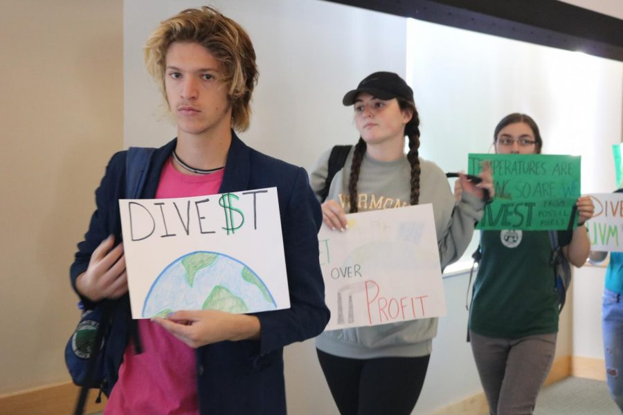 Sophomore+Drew+Baker+and+first-year+Bella+Federico+protests+alongside+other+students+at+the+board+of+trustees+meeting+Oct.+20.