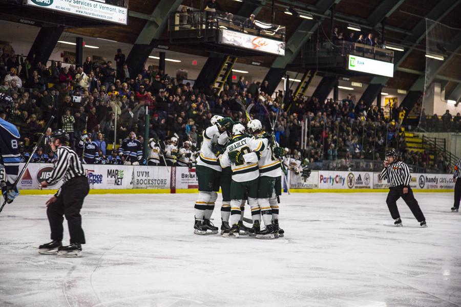 The+men%E2%80%99s+hockey+team+celebrates+after+scoring+a+goal+against+the+University+of+Maine+March+3.+The+Catamounts+opened+their+season+with+a+6-1+over+the+University+of+Waterloo.+%0A