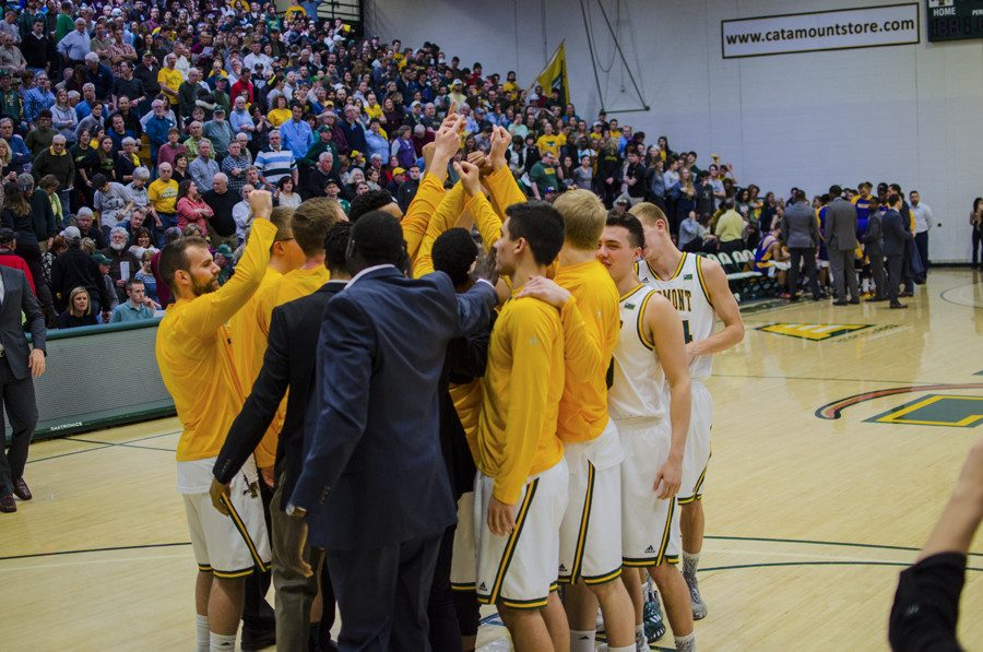 The+men%27s+basketball+team+huddles+together+before+a+game+Feb.+2.+The+Catamounts+have+high+expectations+for+this+year+after+finishing+last+season+with+a+perfect+conference+record.