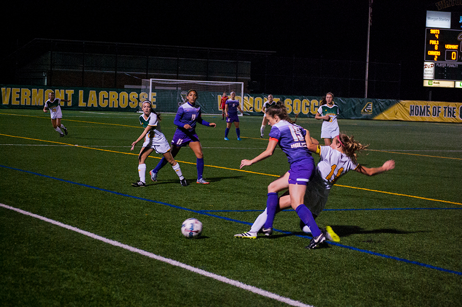 Junior Brooke Jenkins kicks the ball away from a University at Albany player Oct. 12. Jenkins scored the winning goals in the last two games of the America East championship against Albany and Binghamton University.