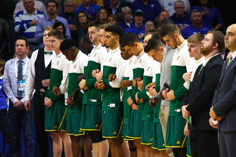 The+men%E2%80%99s+basketball+team+stands+for+the+National+Anthem+against+the+University+of+Kentucky+Nov.+12.+The+unseeded+Catamounts+lost+to+No.+5+Wildcats+73-69.%0A%0A