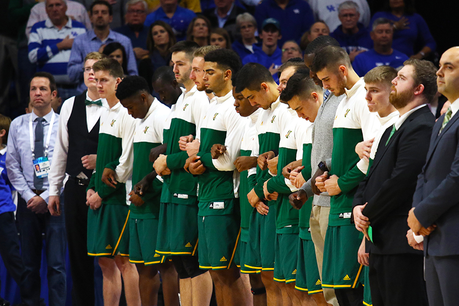 The men's basketball team stands for the National Anthem against the University of Kentucky Nov. 12. The unseeded Catamounts lost to No. 5 Wildcats 73-69.