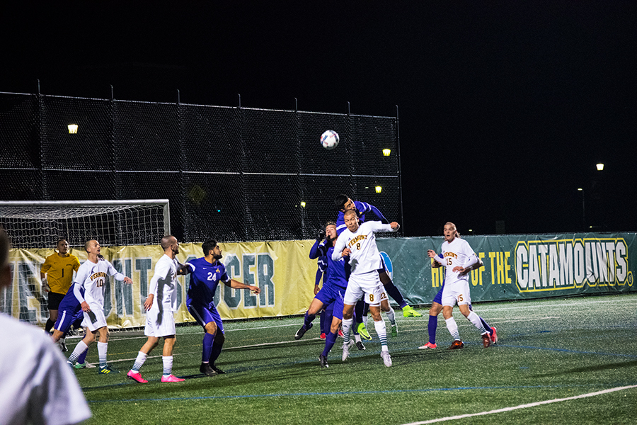 Sophomore Arnar Steinn Hansson (top) and Junior Dani Rovira (bottom) battle for the ball against the University at Albany Nov. 8. The Catamounts lost to the Great Danes 1-0.