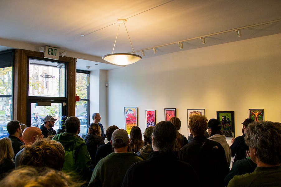 "Burlington community members take in Phish memorabilia at the new Flynn Center exhibition ""Phish in the Northern Country"" Nov. 4. Everything on display, including Phish posters and their own Ben & Jerry's flavor, was donated by archivist Kevin Shapiro."