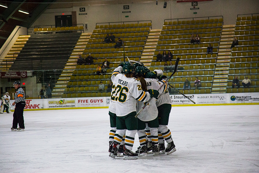 The women's hockey team celebrates a goal against the University of New Hampshire Oct. 10. The Catamounts hold a 5-12-3 record.