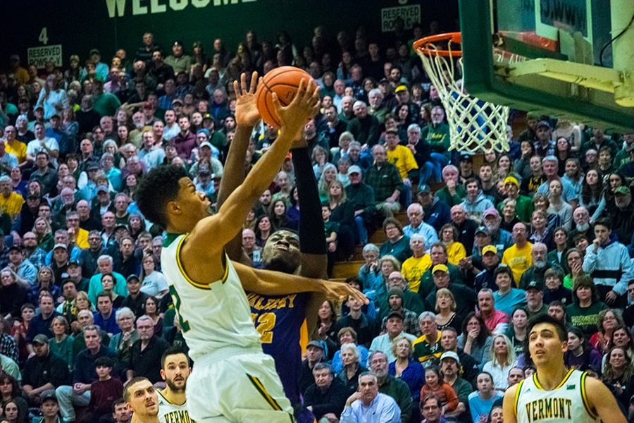 Senior Trae Bell-Haynes drives to the rim against Albany Jan. 24. The Catamounts are currently 7-0 in conference play.