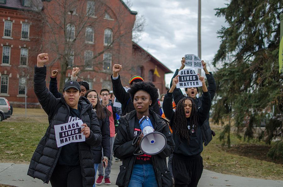 Protesters, led by Harmony Edosomwan, move from the Davis Center to Waterman Feb. 23.