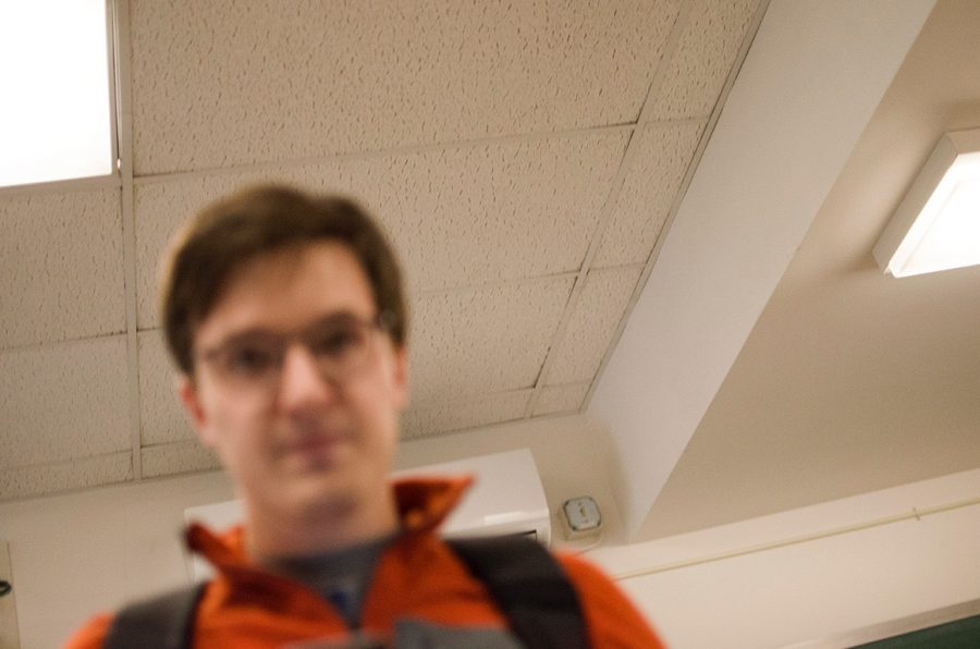 Cynic photographer Oliver Pomazi is the subject of this picture which Cates  took while trying to delete photos of his class Feb. 26. Pomazi said that Cates grabbed him by the arm, took his camera and handed the camera to his first-year student Silas Mueller to delete the photographs.