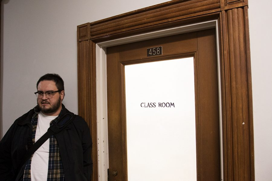 UVM lecturer Isaac Cates stands outside of his classroom Feb. 26 in the Waterman building after his class let out. Cates said he deleted photographs of his class taken by senior Oliver Pomazi because they were a violation of privacy.