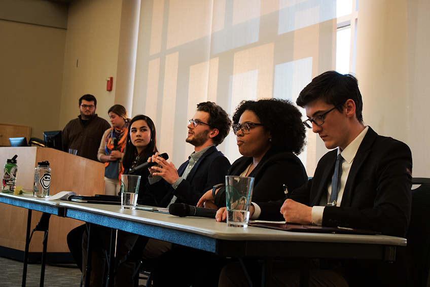 Gillian Natanagara, Ethan Foley, Jamie Benson, and Reginah Mako at the SGA Debate March 26.