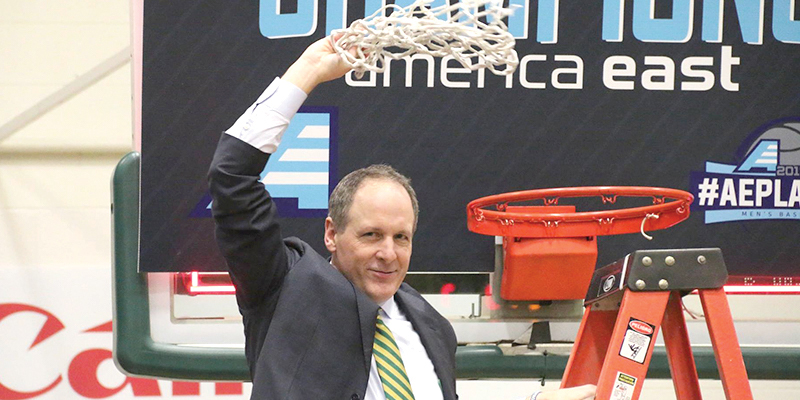 Men's basketball head coach John Becker cuts the net last year after beating University at Albany, securing their spot in the March Madness tournament. It was Becker's second America East championship win.