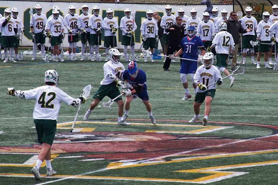 Sophomore+Ben+French+and+freshman+Liam+Limoges+double-team+an+opposing+player+in+the+UVM+Lacrosse+14-7+win+against+UMass+Lowell.+French+and+Limoges+scored+scored+4+and+5+goals+each+respectively.