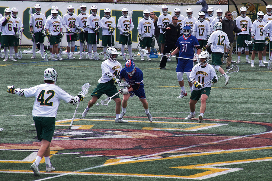 Sophomore Ben French and freshman Liam Limoges double-team an opposing player in the UVM Lacrosse 14-7 win against UMass Lowell. French and Limoges scored scored 4 and 5 goals each respectively.