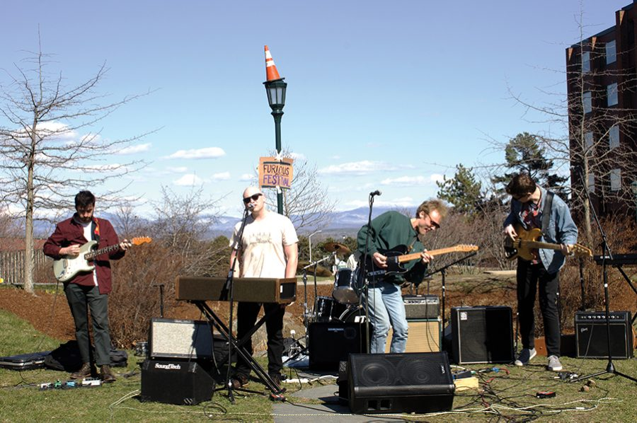 The band J Bengoy plays in the Amphitheater at the Furious Festival, a day long event that showcased student artwork and raised money for the South End Business and Arts Association April 21.