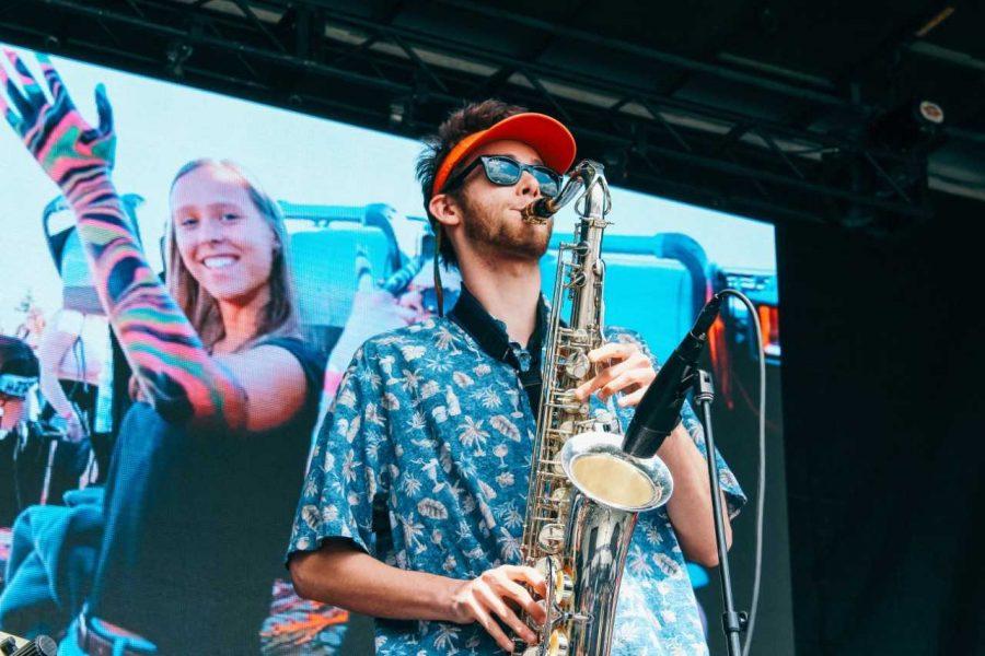 Senior Derek Dykstra, saxophonist for the band Adventure Dog, opens for rapper Playboy Carti at UVM Program Board 's annual SpringFest April 28.