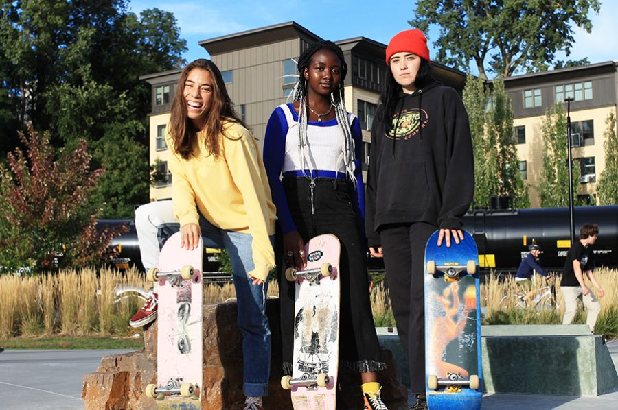 """Junior Paige Van Patten, sophomore Ivana Djiya and junior Abby Trombley pose for a photo at the Andy A. Dog Skate Park on Waterfront North. """"I've heard a lot of girls talk and say, 'I'm too scared,' but no one is really bothered by the fact you're learning,"""" Van Patten said."""
