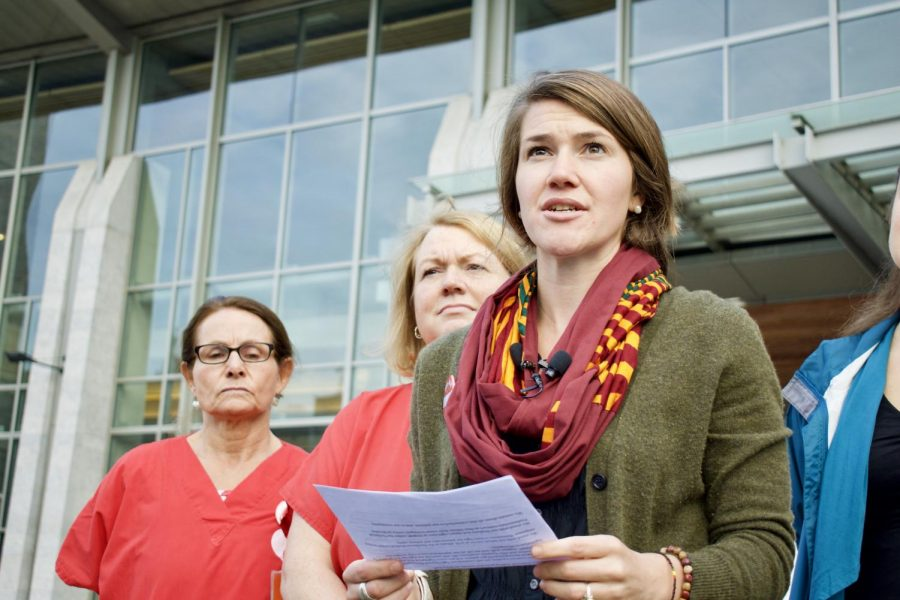 Molly Wallner, lead negotiator for the nurses, reads from a statement at a Sept. 28 press conference outside UVMMC.