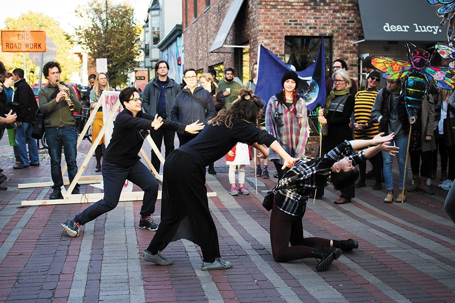UVM dance Professor Paula Higa and senior Phoebe Tucker freestyle dance Oct. 20 on Church Street at the Feverish World Festival. The dancers were part of a bigger group who are in Higa's Ballet and Contemporary Dance class who volunteered to join in the festival.