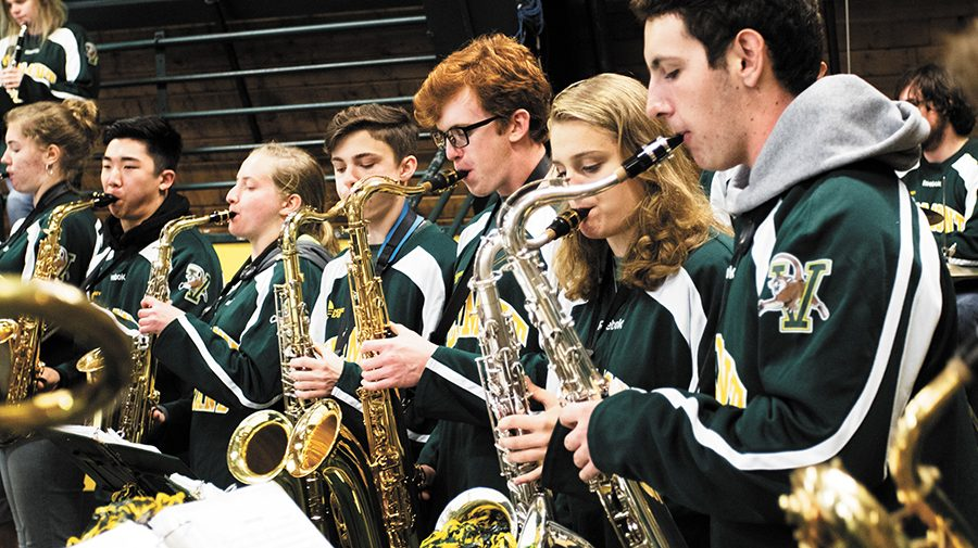 The saxophone section of the Catamount Pep Band play at the Women's Ice Hockey game against the University of Connecticut Oct. 6. The Catamount Pep Band, consisting of 40-50 students, is the official band of the UVM athletic teams.
