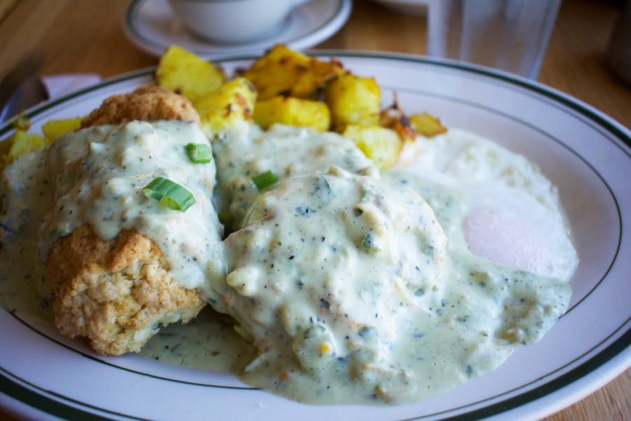 %E2%80%9CThe+Penny+Cluse%E2%80%9D+offers+a+modern+take+on+a+classic+dish+with+flaky+biscuits+served+with+eggs+smothered+in+herb+cream+gravy.