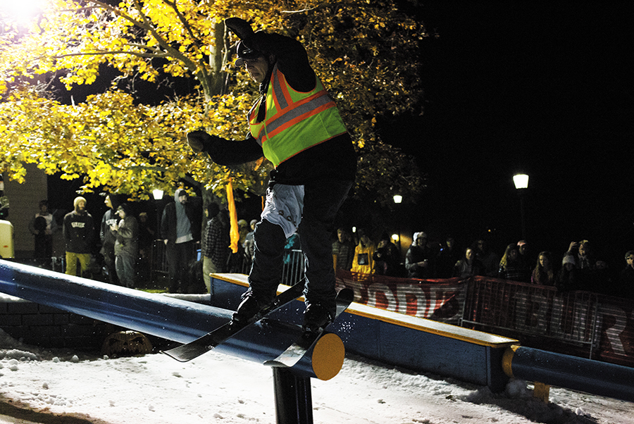 Junior+Sage+Blackburn+skis+down+the+rail+at+UVM+Ski+and+Snowboard+Club%E2%80%99s+annual+rail+jam+Oct.+25.