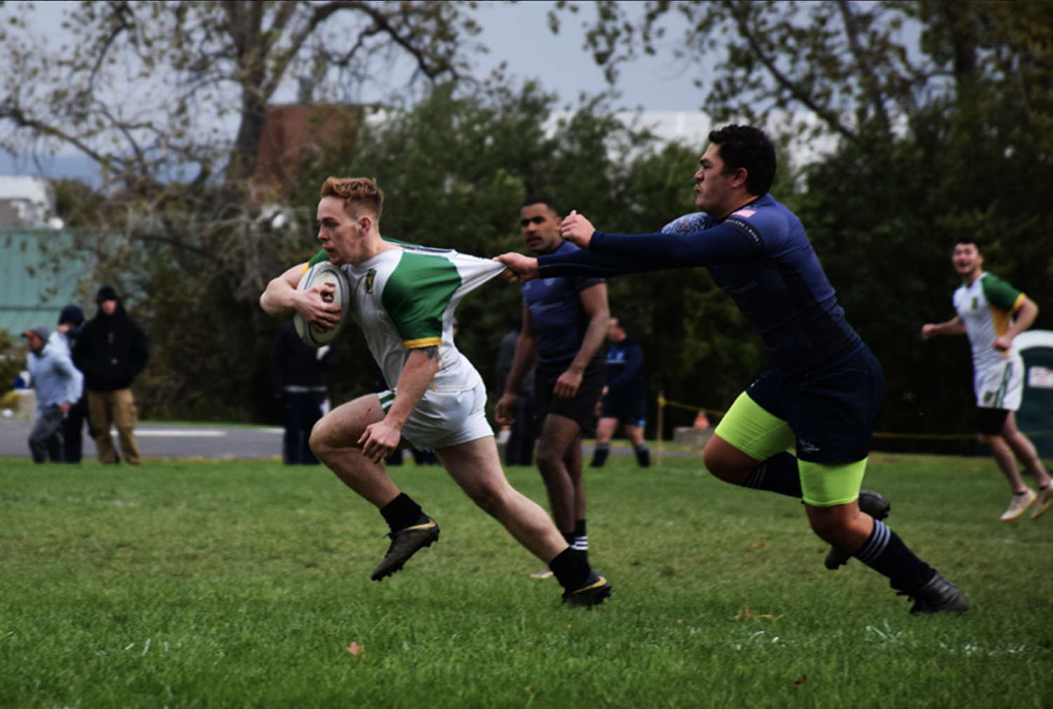 Blindside flanker Pat Rainford pulls away from the grip of a Quinnipiac Men's Rugby Team player Oct 21. The team defeated Quinnipiac with a final score of 68-15.