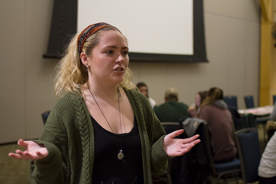 Sophomore Syd Ovitt speaks Dec. 9 at an Explain the Asterisk event. The movement gained suport from Philip Barith, a UVM English professor and the chair of the Vermont Senate Education Committee, who said that he will be proposing policy in January.