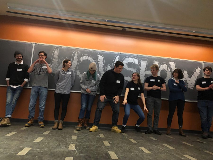 Members of UVM's only improv troupe, Name Pending, prepare to begin their Winter Week of Welcome show Jan. 22. Junior Matthew Noenickx was the host for the night in a show that featured a group of improvisors playing out a series of skits and games.