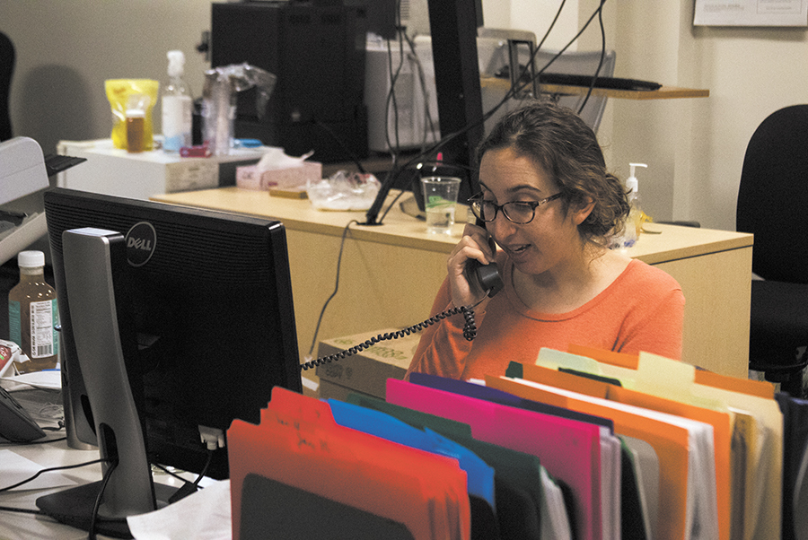 A worker at the Vermont Consumer Assistance Program takes a call Jan. 18. Students can work for CAP by mediating disputes between businesses and consumers, spreading information about scams in the Vermont area, for class credit.