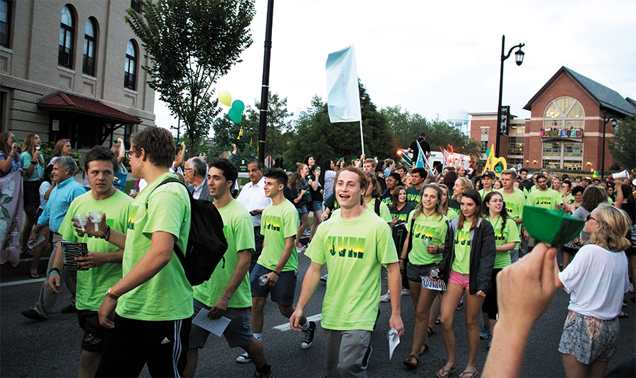 First-year students walk down Main Street Aug. 26, 2019 on their way to the University green at convocation.