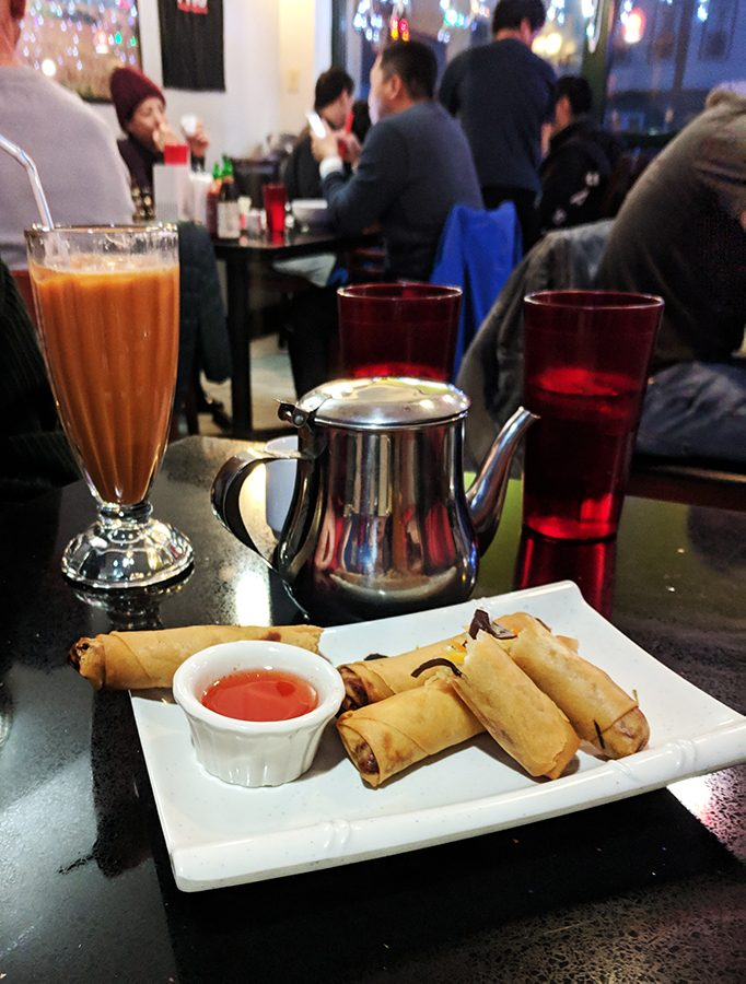 Spring rolls and Thai iced tea wait to be eaten as appetizers at Pho Hong, a restaurant located on North Winooski Avenue. Pho Hong serves a wide variety of Vietnamese food.