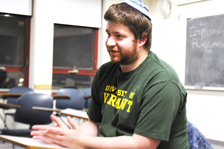 """Junior Tyler Lederer sings at The Niggun Collective Club meeting Jan. 30. The club is a gathering of students who practice niggun singing, a melody that originated in Jewish religion, a wordless tune that uses musical sounds such as """"lai-lai-lai"""" and """"ya da dai."""""""
