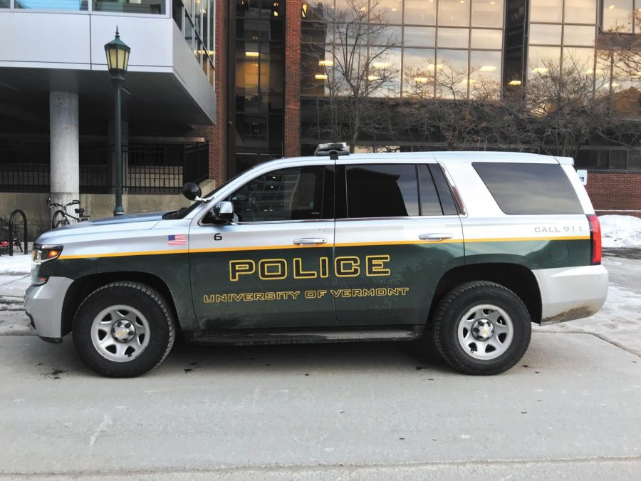 A UVM police services car idles outside the Central Campus Residence Hall Feb. 13. A phone scam made to look like it's coming from UVM police services demanding money has been targeting UVM students.
