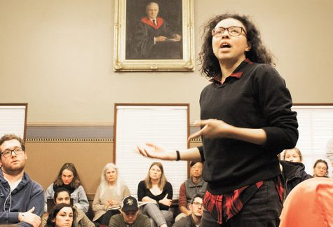 A portrait of UVM graduate John Dewey, a philosopher and proponent of an education as a means of social reform, overlooks the John Dewey Lounge as sophomore Charlotte Looby delivers an impassioned speech Feb. 5 at a United Academics meeting.