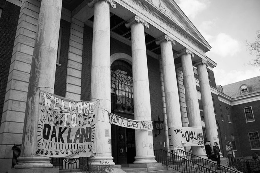 Posters wrap the marble columns of the Waterman building the student activist group NoNames For Justice take-over of the building Feb. 26, 2018.